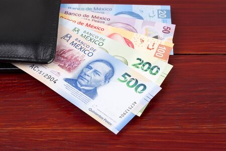 Mexican peso in the black wallet