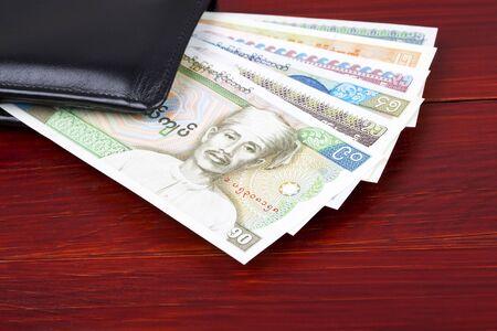 Burmese money in the black wallet