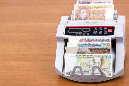 Burmese money in a counting machine