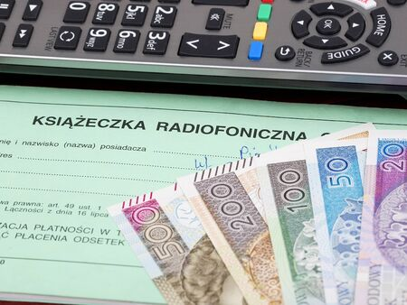 Polish TV subscription booklet with a remote control and money Zdjęcie Seryjne
