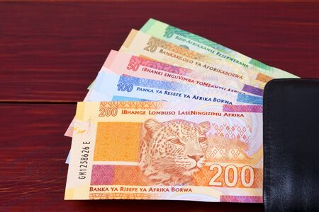 South African money in the black wallet 스톡 콘텐츠