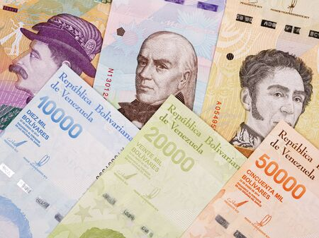 Venezuelan Bolivar a business background with new series of banknotes