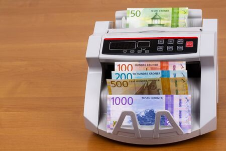 Norwegian money - Krone in a counting machine