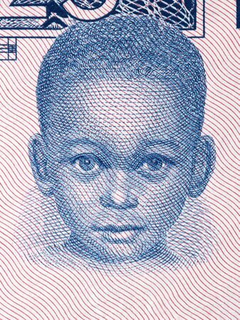 Young boy a portrait from old Guinean money