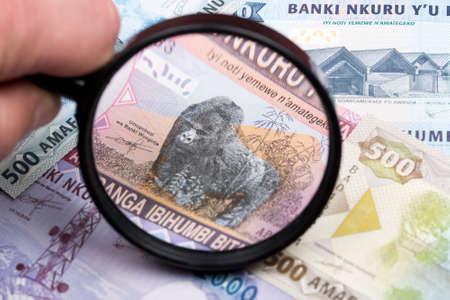 Rwandan franc in a magnifying glass