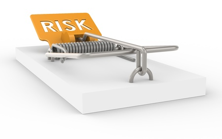 Risk Management. Mousetrap with Risk sign as Bait. photo