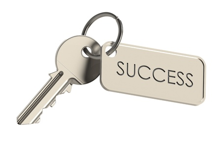 keys to success: Key on a keyring. Success concept. Isolated on white
