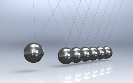friction: Newtons cradle Reflective Floor. Pendulum Stock Photo