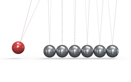 Newtons cradle White floor. One red Ball in the Pendulum.