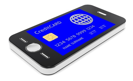 secure payment: Mobile Phone with a Credit Card Screen Stock Photo