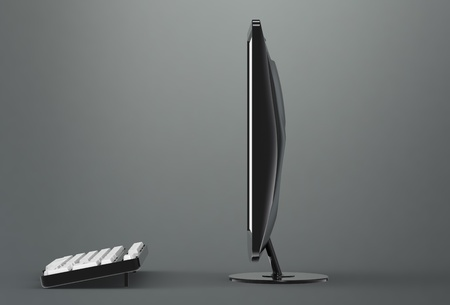 work station: Computer Screen and keyboard. Side view. Gradient dark background Stock Photo
