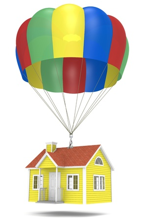 House hanging from a parachute. photo