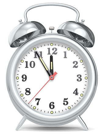 five to twelve: Classic alarm clock with hands at five to twelve. Metal. Stock Photo