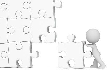 one piece: Lone worker  The Dude assembling large white puzzle   Stock Photo