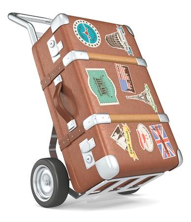 antique suitcase: Retro Suticase. Vintage suitcase with retro travel stickers on a trolley.