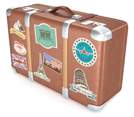 maleta: Maleta de la vendimia. Maleta de cuero con pegatinas retro de viaje. Foto de archivo