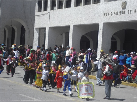 children parading with typical local dress Huaraz Peru