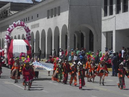 children parading with typical local dress Huaraz Peru