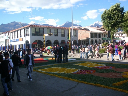 Students prepare carpets in the street