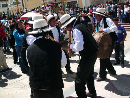 Andean musicians performing a melody