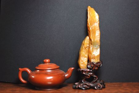 Chinese Teapot and Artistic rock photo