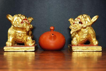 Golden Lions and an asian teapot photo