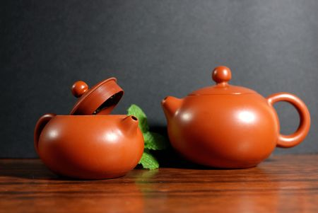 Asian teapot with sprigs of mint for tea photo