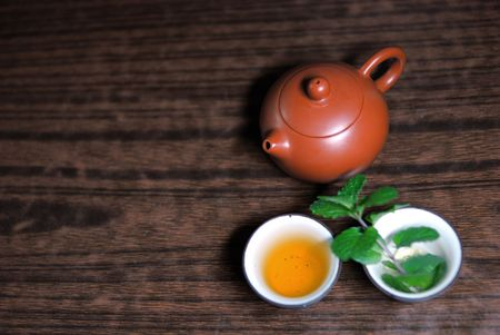 Asian teapot with sprigs of mint for tea Stock Photo - 4652268