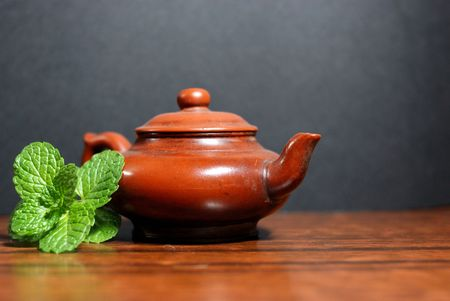 quenched: Asian teapot with sprigs of mint for tea