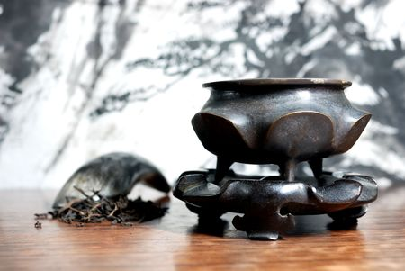 Oriental tea set with the water painting background