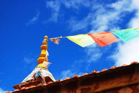 Tibetan symbol with blue sky photo
