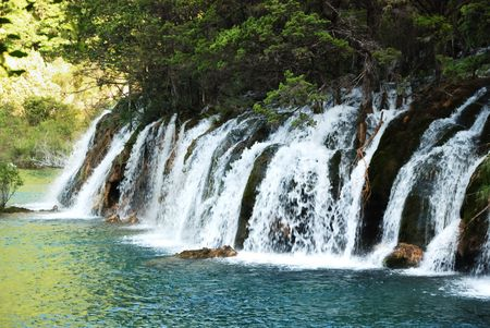 the beautiful waterfall on blue water 版權商用圖片