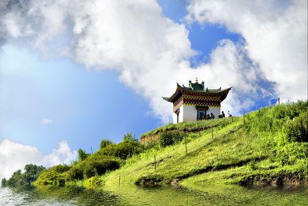 grassplot: isolated sacred house on grassplot