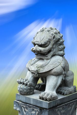 asian stone lion with blue sky photo