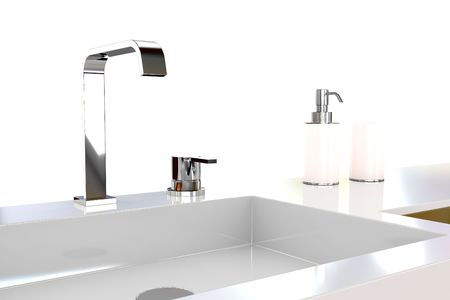 Water faucet in silver and white basin photo