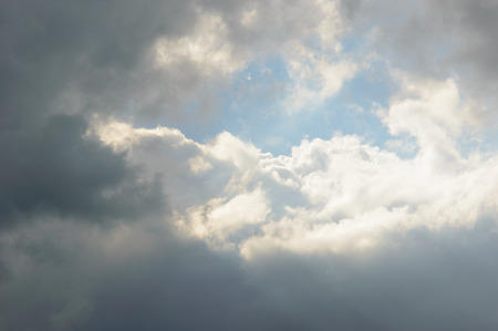 inclement: Bright sun reflected on clouds in sky with copy space for moody transfiguration concept background Stock Photo