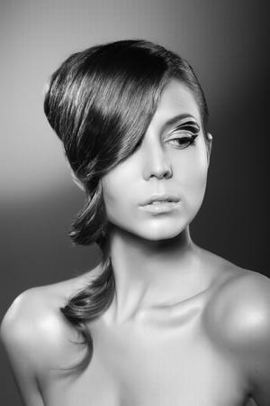 A beautiful girl posing on dark background Stock Photo - 9742227