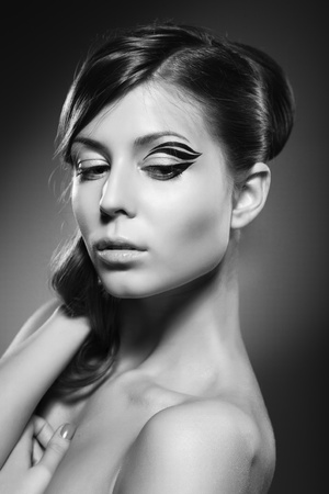 A beautiful girl posing on dark background Stock Photo - 9742222
