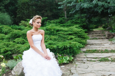 A beautiful bride in the white wedding dress. photo