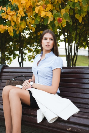 Portrait a beautiful caucasian woman  in the park photo