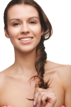 handholding: Beautiful natural look young girl with brown hair on white background handholding her hair