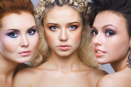 young teen girl nude: Closeup three beautiful young girls standing together Stock Photo
