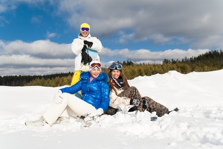 wallowing: Young people are enjoying the sun and snow, wallowing in the snow Stock Photo