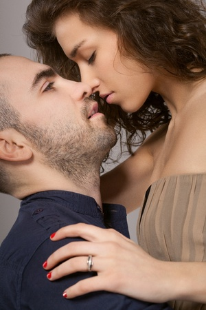a beautiful young girl is kissing a hot guy photo
