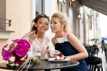 Lovely women drinking her tea while chatting. See more images from the same shoot. outdoors Stock Photo - 14329914