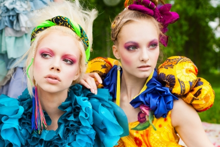 Close-up of two young beautiful ladies in a garden. Outdoors photo