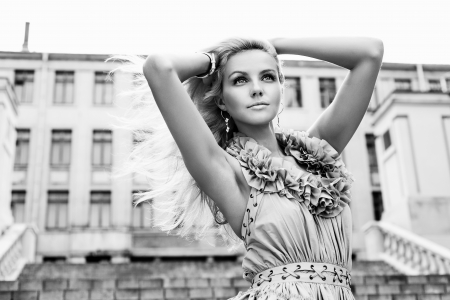 woman fashion:  Portrait of a young pretty woman walking on the streets of old european city. Outdoors