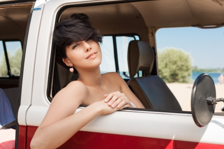 young woman relaxing in car near the beach - outdoors photo