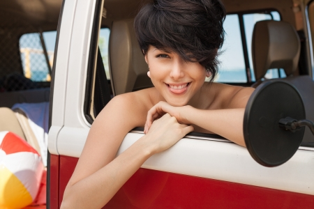 girl showing the language in car near the beach - outdoors Stock Photo - 14745398