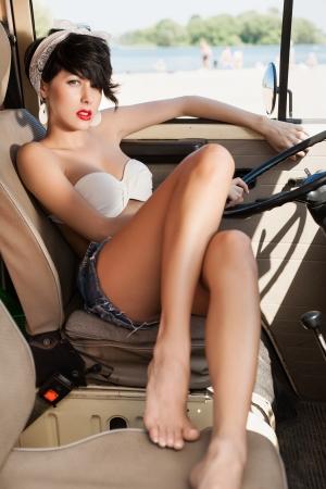 bandana: Beautiful woman relaxing in car near the beach - outdoors Stock Photo